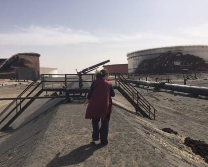 7594a349d Crisis Group on the Ground Crisis Group's Senior Analyst for Libya, Claudia  Gazzini, walks through destroyed crude oil storage tanks in the Sidra tank  farm, ...